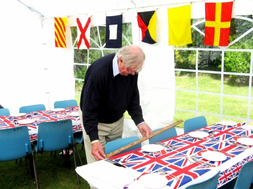 Peter Burman preparing tables for 2012 'Jubilee' Garden Party