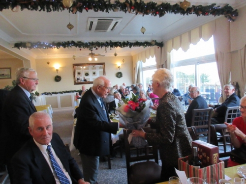 13th December 2019 Alan Tulloch presents Pam Snow a bouquet to say farewell.