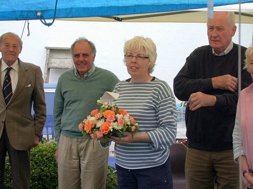 Georgie Hibberd presented with bouquet at 2007 BBQ. Hedley Kett, Peter Goldberg and Tony McGinnity behind.