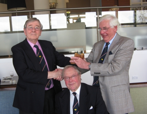 Graham Hall handing over the 'Gavel of Office' as Robin Ebsworth takes over as Chairman, April 2013. (Over Peter Burman's head)