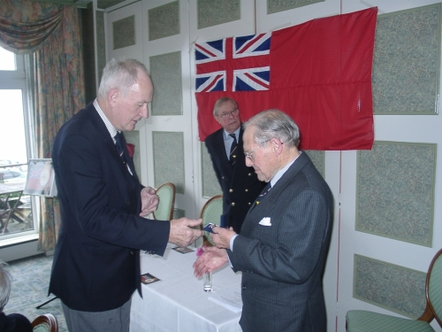 Tony McGinnity presenting Hedley Kett with his Merchant Navy Veteran's Badge February 2007