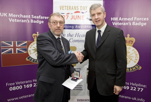 Ted Sandle receiving Merchant Navy Veteran's Badge from the Minister at the Imperial War Museum, January 2008